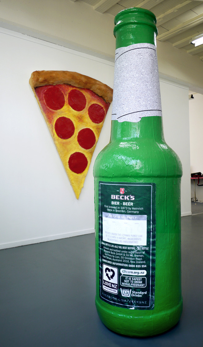 back of bottle and pizza womanfinal